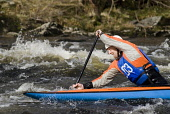 A white water kayaker racing at Grandtully, Perthshire.  Picture Credit : Martin Knight / Scottish Viewpoint  Tel: +44 (0) 131 622 7174  E-Mail : info@scottishviewpoint.com  Web: www.scottishviewpoint... Public, NMR 2010,sunny,activity,outdoors,kayaking,paddling,paddler,single,sport,competition,race,event,exercise,fit,fitness,well being,health,river tay,rivers,watercourse,people,man,male