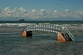 Bridge to Nowhere at Belhaven bay - at high tide the reason for this bridge is not obvious, near Dunbar, East Lothian. Picture Credit : Jack Byers / Scottish Viewpoint  Tel: +44 (0) 131 622 7174  E-Ma... Public 2012,summer,sunny,coast,coastal,water,bass,rock,john,muir,country,park,footbridge,no,where