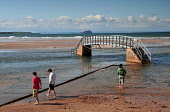 Bridge to Nowhere at Belhaven bay - at high tide the reason for this bridge is not obvious, near Dunbar, East Lothian. Picture Credit : Jack Byers / Scottish Viewpoint  Tel: +44 (0) 131 622 7174  E-Ma... Public 2012,summer,sunny,coast,coastal,water,bass,rock,john,muir,country,park,footbridge,no,where,people,paddling
