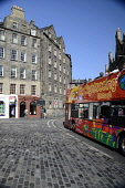 A City Sightseeing bus passing through the Grassmarket, Edinburgh. Picture Credit : Neil Sinclair / Scottish Viewpoint  Tel: +44 (0) 131 622 7174  E-Mail : info@scottishviewpoint.com  Web: www.scottis... Public 2011,summer,sunny,city,double,decker,open,topped,attraction,visitor,tourist,tourists,people,old,town,cobbles