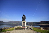 The War Memorial on Glenelg Bay, Glenelg, with a view beyond to the Isle of Skye (left), Highlands of Scotland. Picture Credit : Chris Robson / Scottish Viewpoint  Tel: +44 (0) 131 622 7174  E-Mail :... Public 2010,summer,sunny,sound,sleat,water,highland,roll,honour,commemorate,statue,sculpture
