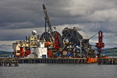 An Oil Pipe laying vessel at Invergordon, Cromarty Firth, Highlands of Scotland. Picture Credit : Laurence Leech / Scottish Viewpoint  Tel: +44 (0) 131 622 7174  E-Mail : info@scottishviewpoint.com  W... Public 2009,summer,deephaven,industry,platform,water,equipment,highland