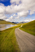 The single track road by Loch Quoich, Highlands of Scotland. Picture Credit : Laurence Leech / Scottish Viewpoint  Tel: +44 (0) 131 622 7174  E-Mail : info@scottishviewpoint.com  Web: www.scottishview... Public 2011,summer,sunny,hills,mountains,knoydart,clouds,water,remote