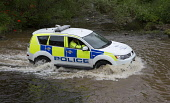 A Lothian and Borders Police car driving through a ford. Picture Credit : Mike Clarke / Scottish Viewpoint  Tel: +44 (0) 131 622 7174  E-Mail : info@scottishviewpoint.com  Web: www.scottishviewpoint.c... Public 2011,water,4WD,constabulary,force,people