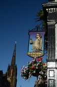 The sign for Deacon Brodie's tavern on the Royal Mile in the city centre of Edinburgh. Picture Credit : Neil Sinclair / Scottish Viewpoint  Tel: +44 (0) 131 622 7174  E-Mail : info@scottishviewpoint.c... Public 2012,summer,sunny,old,town,pub,public,house,drink,drinking,signage,flowers,hanging,basket,spire
