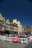 Al fresco eating and drinking in the Grassmarket in the city centre of Edinburgh. Picture Credit : Neil Sinclair / Scottish Viewpoint  Tel: +44 (0) 131 622 7174  E-Mail : info@scottishviewpoint.com  W... Public 2012,summer,sunny,building,architecture,old,town,food,outdoor,tables,bar,drink,people