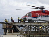 Offshore oil workers boarding a Sikorsky S92 helicopter for Aberdeen from an oil platform in the North Sea. Picture Credit : Allan Coutts / Scottish Viewpoint  Tel: +44 (0) 131 622 7174  E-Mail : info... Public 2012,summer,rig,gas,production,industry,industrial,helideck,people