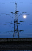 Electricity pylon by Holl Reservoir, Fife. Picture Credit : Mike Clarke / Scottish Viewpoint   Tel: +44 (0) 131 622 7174  E-Mail : info@scottishviewpoint.com  This photograph cannot be used without pr... Public 2010,summer,night,moon,moonlight,energy,industry,silhouette