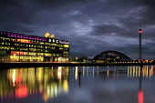 BBC Scotland building and Glasgow Science Centre by the River Clyde, west of the city centre of Glasgow, at dusk.  Picture Credit : Tony Clerkson / Scottish Viewpoint   Tel: +44 (0) 131 622 7174  E-Ma... Public 2010,summer,architecture,urban,buildings,cloud,clouds,auditorium,building,landmark,light,modern,night,nightscape,place,reflection,water,lights,dusk,atmospheric,moody,calm,visitor,turist,attraction