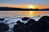 Sunset over the Firth of Clyde near Gourock, Inverclyde. Picture Credit : Tony Clerkson / Scottish Viewpoint   Tel: +44 (0) 131 622 7174  E-Mail : info@scottishviewpoint.com  This photograph cannot be... Public 2011,summer,atmospheric,dusk,twilight,coast,coastal,seascape,sunlit,sunlight,golden,glow,rugged,shore,rocks,rocky,beach,seashore,beautiful,light,scenic,scenery,tranquil,tranquility,beauty,peaceful