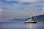 Yacht anchored on Loch Ness near to Dores, Highlands of Scotland. Picture Credit : Laurence Leech / Scottish Viewpoint   Tel: +44 (0) 131 622 7174  E-Mail : info@scottishviewpoint.com  This photograph... Public 2012,summer,sunny,boat,sailing,activity,Caledonian,Canal,British,Waterways,Nessie,Great,Glen,water,hills,highland