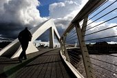 The Tradeston Bridge also known as the Squiggly Bridge over the River Clyde, Glasgow.  Picture Credit : Tony Clerkson / Scottish Viewpoint   Tel: +44 (0) 131 622 7174  E-Mail : info@scottishviewpoint.... Public 2012,summer,sunny,atmospheric,urban,city,architecture,structure,engineering,pavement,footbridge,Broomielaw,dark,clouds,people