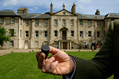A member of staff at Newhailes House in Musselburgh, East Lothian, shows off a 3500-year-old Egyptian relic discovered in the grounds of the house which will be open to the public for the first time t... Colin McPherson