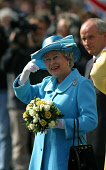GLASGOW, SCOTLAND, UK: The Queen points enthusiastically to the fly-past by the RAF Tornadoes over the city's George Square on the first day of her 1000-mile, seven day Golden Jubilee tour of Scotland... Colin McPherson