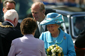 GLASGOW, SCOTLAND, UK: The Queen, accompanied by Prince Phillip is welcomed to the city's George Square on the first day of her 1000-mile, seven day Golden Jubilee tour of Scotland. Earlier the Queen... Colin McPherson