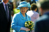 GLASGOW, SCOTLAND, UK: The Queen looks towards crowds of wellwishers in the city's George Square on the first day of her 1000-mile, seven day Golden Jubilee tour of Scotland. Earlier the Queen attende... Colin McPherson