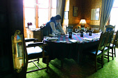 Skibo Castle, Dornoch, Sutherland, Scotland: Member of staff Angeline MacLeod prepares Andrew Carnegie's study for an informal dinner at the Castle.  Photograph � Colin McPherson, 09/04/02. Tel. +44 (... Colin McPherson
