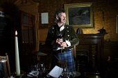 Skibo Castle, Dornoch, Sutherland, Scotland: Host and hotel jester Alan Grant, prepares to give the pre-dinner toast to members of the Carnegie Club in Andrew Carnegie's study at the Castle.  Photogra... Colin McPherson