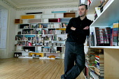 Artist Andrew Miller pictured with the book cases he designed which are installed in a Glasgow house. PIC:COLIN MCPHERSON/ SCOTTISH VIEWPOINT Tel: +44 (0) 131 622 7174   Fax: +44 (0) 131 622 7175 E-Ma... PUBLIC, NMR