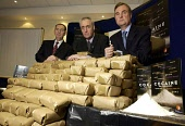 (left to right ) Andrew Cameron Chief Constable Central Scotland Police; Hugh Henry MSP Deputy Justice Minister and Jim Orr Director of the Scottish Drugs Enforcement Agency,  with a mock up of GBP 50... POLITICS