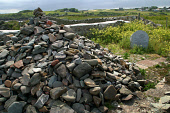 The Witness Cairn, constructed by Christian pilgrims and visitors at the ruins of St. Ninian's Chapel, Isle of Whithorn, Dumfries and Galloway, Scotland. St. Ninian was the first Christian pilgrim to...
