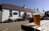 The Old Forge pub  Inverie, with pint outside. Loch Nevis Knoydart Picture ALLAN MILLIGAN /SCOTTISH VIEWPOINT Tel: +44 (0) 131 622 7174   Fax: +44 (0) 131 622 7175 E-Mail : info@scottishviewpoint.com...