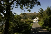 Walkers in  Inverie. Knoydart Picture ALLAN MILLIGAN /SCOTTISH VIEWPOINT Tel: +44 (0) 131 622 7174   Fax: +44 (0) 131 622 7175 E-Mail : info@scottishviewpoint.com This photograph can not be used witho... TOURISM,TREES,TOURISTS