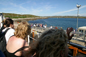 Passengers on the Caledonian MacBrayne ferry 'Clansman' waving at islanders waving on the pier at Arinagour on the inner-Hebridean island of Coll, Argyll, as the ferry service departs for Oban. Pic Co... TRANSPORT,SEA,TOURISTS