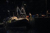 EYEMOUTH, SCOTLAND, UK: A fishing boat unloading her catch at the port of Eyemouth on Scotland's east coast after fishing in the North Sea for cod, haddock, whiting and prawns. Proposals by scientists... Colin McPherson