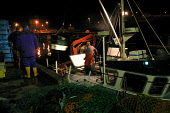 EYEMOUTH, SCOTLAND, UK: Fishermen unloading their catch from a trawler at the port of Eyemouth on Scotland's east coast after fishing in the North Sea for cod, haddock, whiting and prawns. Proposals b... Colin McPherson