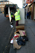 Workmen from the council cleansing department clearing up  rubbish piled up in Duke Street, Glasgow. The nearby Reidvale Housing Association is complaining of discrimination in rubiish collections in... Colin McPherson