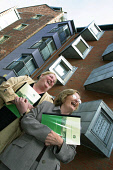 Margaret Curran MSP (right), Minister for Social Justice in the Scottish Parliament, with tenant Hazel Hawkins from Edinburgh, pictured outside her home holding copies of the new agreement after a cer... Colin McPherson