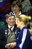 A spectator watches members of Team Martin, the British Olympic gold medal winning curling team, being introduced to the crowd at the Braehead arena in Glasgow before a special challenge match against... Colin McPherson