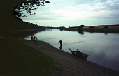 Time & Tide: Salmon netters at Paxton House, the last fishery on the Scottish side of the river Tweed in Berwickshire, haul their net ashore at dusk on a late summer evening as the season, which ends... Colin McPherson