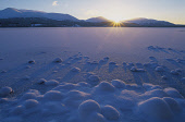 LOCH MORLICH AT SUNSET IN THE MIDDLE OF WINTER. HIGHLAND. Peter Cairns/ Scottish Viewpoint Tel: +44 (0) 131 622 7174   Fax: +44 (0) 131 622 7175 E-Mail : info@scottishviewpoint.com This photograph sho... HILLS,WINTER,TEXTURE,SNOW,ICE