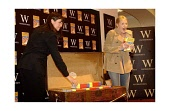 JK Rowling as she signs some of the Harry Potter books for a select few children at midnight for the launch of her new book at the Waterstones book shop in Edinburgh. 21/6/03. PIC: JOHN HARDIKER/SCOTT... AUTHOR,WRITER