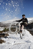 A CYCLIST ON A MOUNTAIN BIKE POSES FOR A PHOTOGRAPH IN THE CAIRNGORM NATIONAL PARK NEAR AVIEMORE, HIGHLANDS OF SCOTLAND. WINTER 2008 PIC:PAUL TOMKINS/VisitScotland/SCOTTISH VIEWPOINT Tel: +44 (0) 131... WINTER,SUNNY,CYCLING,BIKING,SNOW,WHITE,HEATHER,HILL,HILLS,ACTIVITY,HIGHLAND,CAIRNGORMS,CYCLE