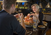 A COUPLE ENJOY A SEAFOOD PLATTER FOR TWO IN THE BAR AND GRILL AT THE DAKOTA FORTH BRIDGE HOTEL, SOUTH QUEENSFERRY, LOTHIANS.  PIC: P.TOMKINS/VisitScotland/SCOTTISH VIEWPOINT  Tel: +44 (0) 131 622 7174... 2008,INTERIOR,EATING,DINING,FINE,FOOD,ROMANTIC,ROMANCE,LOBSTER,CRAB,OYSTERS,LANGOUSTINES,MUSSELLS,CLAMS,SCALLOPS