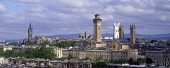 LOOKING OVER ROOFTOPS TO THE BUILDINGS OF PARK CIRCUS, WITH THE TOWER OF THE MAIN BUILDING OF THE UNIVERSITY- A LATE 19TH CENTURY EDIFICE DESIGNED BY GEORGE GILBERT SCOTT, VISIBLE BEYOND, GLASGOW. PIC... Public, nmr