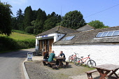 A GROUP OF MOUNTAIN BIKERS OUTSIDE THE BIKE SHOP AND CAFE AT THE MABIE (FOREST) MOUNTAIN BIKING CENTRE NEAR DUMFRIES, SOUTHERN SCOTLAND PIC: P. TOMKINS / VISITSCOTLAND / SCOTTISH VIEWPOINT TEL: +44 (0... Public, NMR 2009,SPRING,BIKES,CYCLES,BICYCLES,ACTIVITY,BIKE,BIKING,BICYCLE,7STANES,FOREST,DUMFRIES,GALLOWAY,SUMMER,PEOPLE