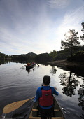 OPEN (CANADIAN) CANOEING IN GLEN AFFRIC, HIGHLANDS OF SCOTLAND. Pic: Paul Tomkins / VisitScotland / Scottish Viewpoint Tel: +44 (0) 131 622 7174 Fax: +44 (0) 131 622 &175 E-Mail: info@scottishviewpoin... Public, MR 2009,SUMMER,CANOE,CANOEIST,PEOPLE,ACTIVITY,GROUP,BOOTS,PADDLES,LOCH,WATER,HIGHLAND,ATMOSPHERIC