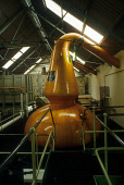 LOOKING OVER TO A WASH STILL (NUMBER 1 WITH CONTENTS OF 30,963 LITRES) AT A WHISKY DISTILLERY. PIC: VisitScotland/SCOTTISH VIEWPOINT Tel: +44 (0) 131 622 7174   Fax: +44 (0) 131 622 7175 E-Mail : info... STILL ROOM,MANUFACTURE,INDUSTRY,INTERIOR