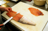 THINLY SLICING SALMON PREPARING THE FILLETS TO BE PUT ON RACKS FOR THE SMOKING PROCESS.PIC:PAUL TOMKINS/VisitScotland/SCOTTISH VIEWPOINTTel: +44 (0) 131 622 7174  Fax: +44 (0) 131 622 7175E-Mail : inf... EATING,COOKING,PEOPLE,WORKER,HYGIENE,FOOD,INDUSTRY,PROCESS,FISH,INTERIOR