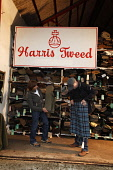 Part of the huge stock of woven Harris Tweed cloth, sold by the length at the Harris Tweed and Knitwear Shop, Tarbert, Isle of Harris, Outer Hebrides. Picture Credit : P.Tomkins / VisitScotland /Scott... Public island,islands,2010,western isles,summer,retail,warehouse,shopping,material,cloth,people