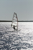 Windsurfing on Loch Bee, Isle of South Uist, Outer Hebrides Picture Credit: P.Tomkins / VisitScotland /Scottish Viewpoint Tel: +44 (0) 131 622 7174   Fax: +44 (0) 131 622 7175 E-Mail : info@scottishvi... Public island,islands,2010,western isles,summer,activity,sport,water