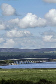 Dornoch Bridge taking the A9 over the Dornoch Firth, Highlands of Scotland. Picture Credit: Paul Tomkins / VisitScotland / Scottish Viewpoint Tel: +44 (0) 131 622 7174   Fax: +44 (0) 131 622 7175 E-Ma... Public 2011,summer,sunny,structure,engineering,road,transport,hill,hills,forestry