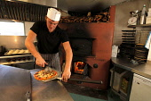 Wood - fired traditional pizza at the Sutor Creek Cafe at Cromarty, Black Isle, Highlands of Scotland.  Picture Credit: Paul Tomkins / VisitScotland / Scottish Viewpoint Tel: +44 (0) 131 622 7174   Fa... Public, MR 2011,interior,food,eating,chef,cooking,people,restaurant,italian