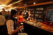 Enjoying a drink at the Old Bridge Inn, Aviemore, Highlands of Scotland Picture Credit: Paul Tomkins / VisitScotland / Scottish Viewpoint Tel: +44 (0) 131 622 7174   Fax: +44 (0) 131 622 7175 E-Mail :... Public, MR 2011,interior,bar,gantry,drinking,pint,glass,wine,barmaid,maid,smile,welcoming,atmospheric,whisky,bottle,couple,people