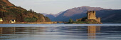 LOOKING ACROSS A CALM LOCH DUICH AON A SUMMER'S EVENING OVER TO EILEAN DONAN CASTLE, HIGHLAND. PIC: P.TOMKINS/VisitScotland/SCOTTISH VIEWPOINT Tel: +44 (0) 131 622 7174   Fax: +44 (0) 131 622 7175 E-M... BUILDING,BRIDGE,FORESTRY,MOUNTAIN,HERITAGE,SUMMER,WATER