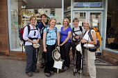 A group of walkers on the St Cuthbert's Way outside the Mainstreet Trading Company - a bookshop, cafe and gift shop in the centre of St Boswells, Scottish Borders.   Picture Credit: Paul Tomkins / Vis... Public 2011,summer,people,ladies,smile,retail,shopping,giftshop,main,street,specialised,town,women